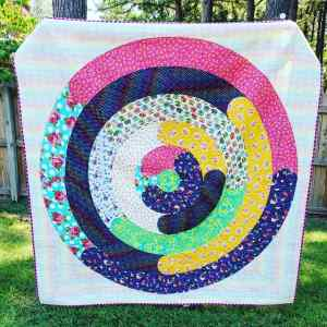 orbital quilt pattern by geeky bobbin. throw size quilt made by Meg Cullum