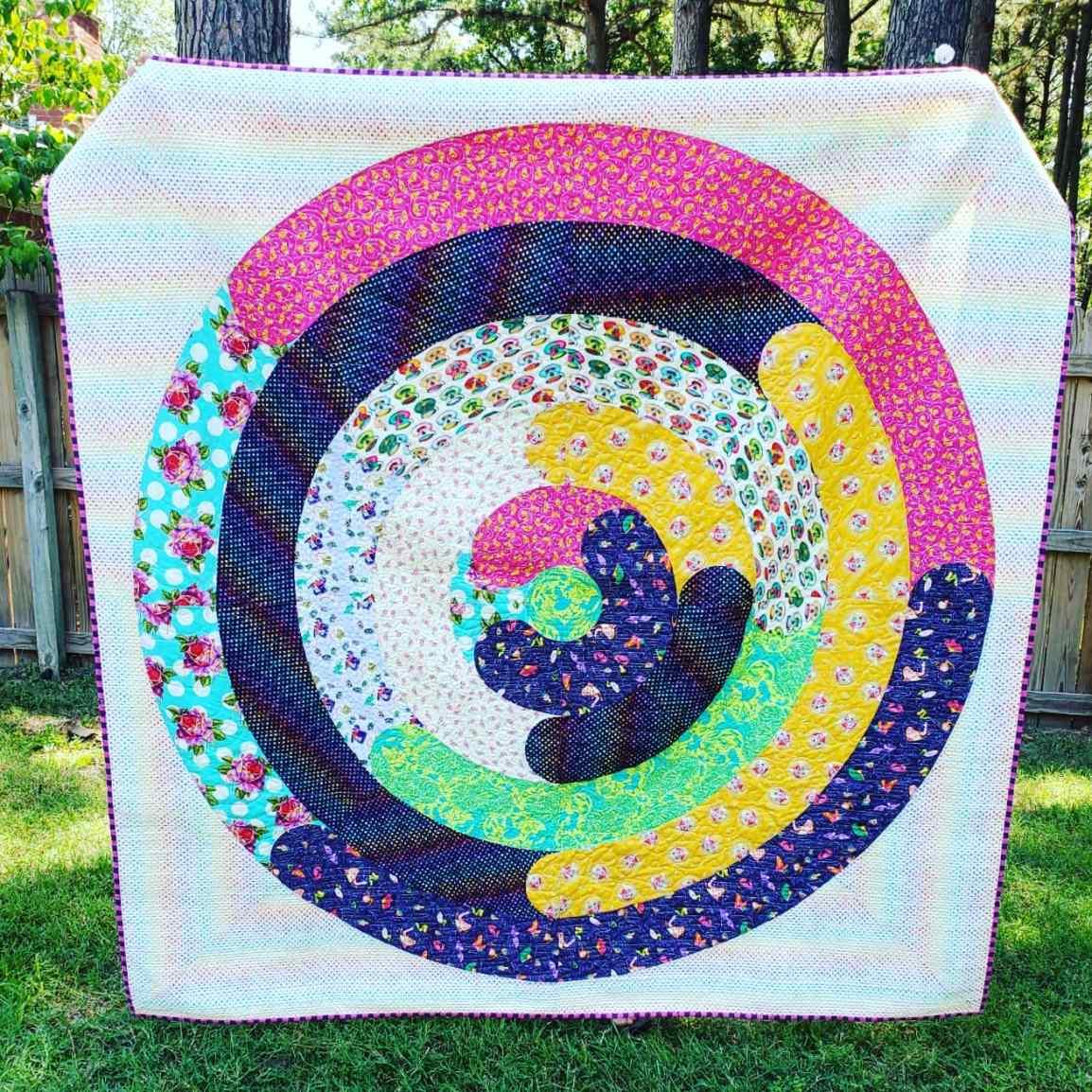 orbital quilt pattern by geeky bobbin. quilt made by Meg Cullum