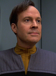 Lt Barclay, wearing yellow TNG uniform