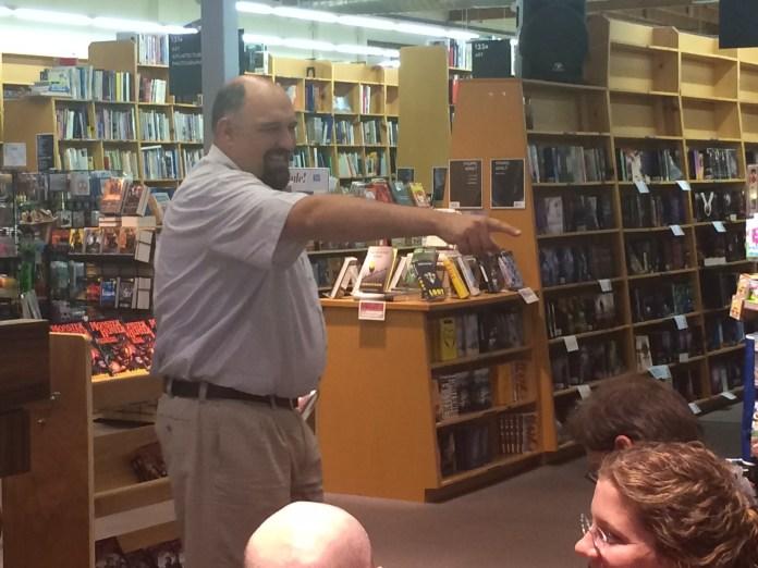 Correia holding an improteu trivia quiz to win hardback books.
