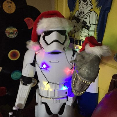 Yes, I put a Santa hat on our giant First Order Stormtrooper. And that puppet came from Disneyland.