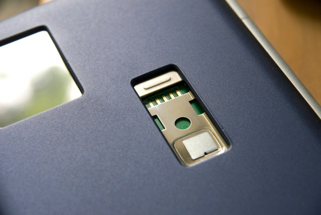 FlipStart accessory connector and SIM slot door