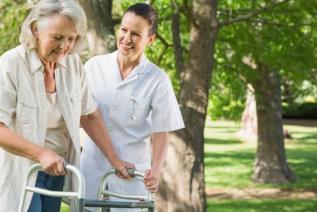 Senior caregiver preventing falls
