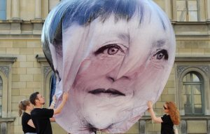 epa04783813 Helpers hold a balloon of the developmental advocacy and campaigning organisation 'ONE' depicting German Chancellor Angela Merkel on the Odeonsplatz in Munich, Germany, 05 June 2015. State and government leaders of the G7 countries are meeting on 07 and 08 June 2015 in Schloss Elmau near Garmisch-Partenkirchen.  EPA/TOBIAS HASE