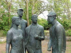 Bronzene Bauern auf der Agra