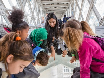 School pupils visiting Tower Bridge & experiencing the views from the glass floor