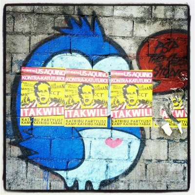 Graffiti covered by anti- noynoy posters