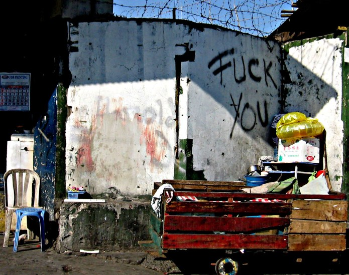 fuck you graffiti on a QC street