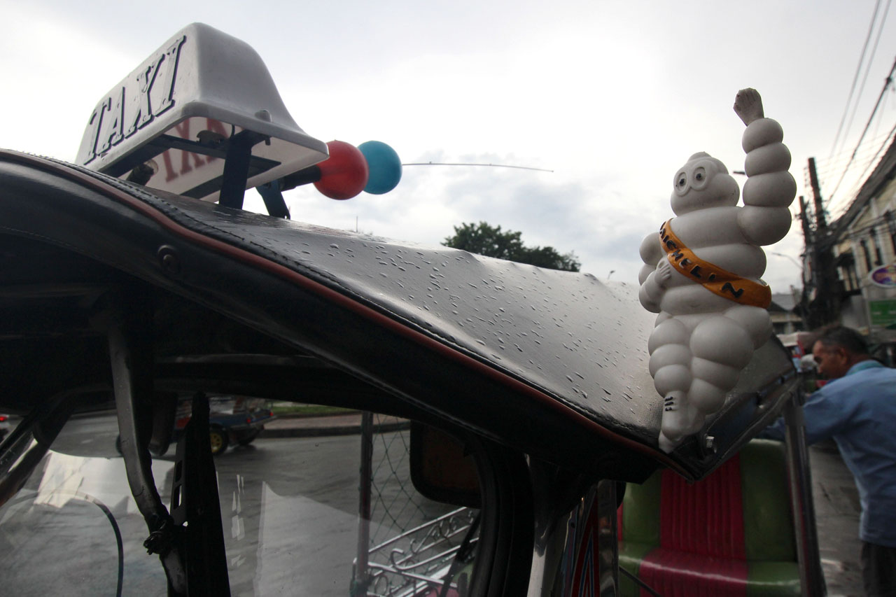 tuktuk with a Michelin man doll