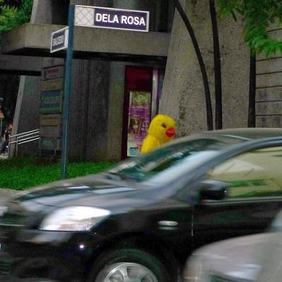 mysterious figure walking along the street