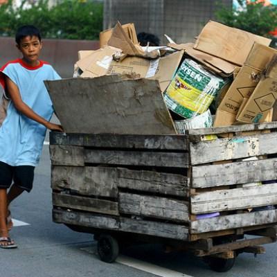 boy pushing a cart