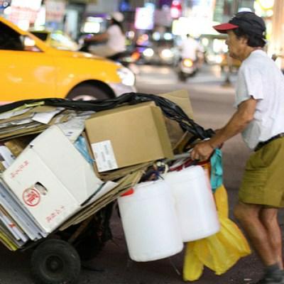 pushcart full of cardboard boxes