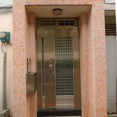 tiled doorway with stainless steel door