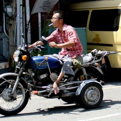 shoeless on a three-wheeler
