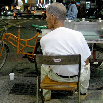 old man selling a tofu based dessert