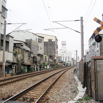 train tracks snaking through a row of houses