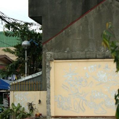 graffiti on a torn down house