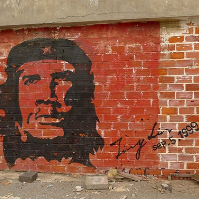 Che Guevara graffiti on red brick