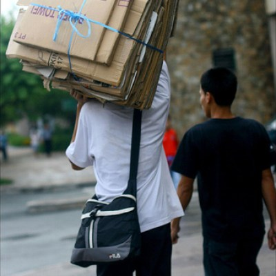 guy carrying flattened cardboard boxes