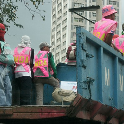 MMDA workers on a truck wearing pink vests