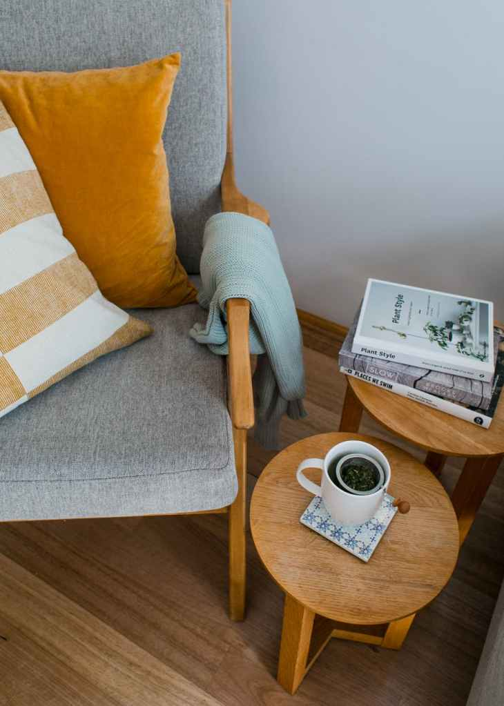 armchair near side tables in room