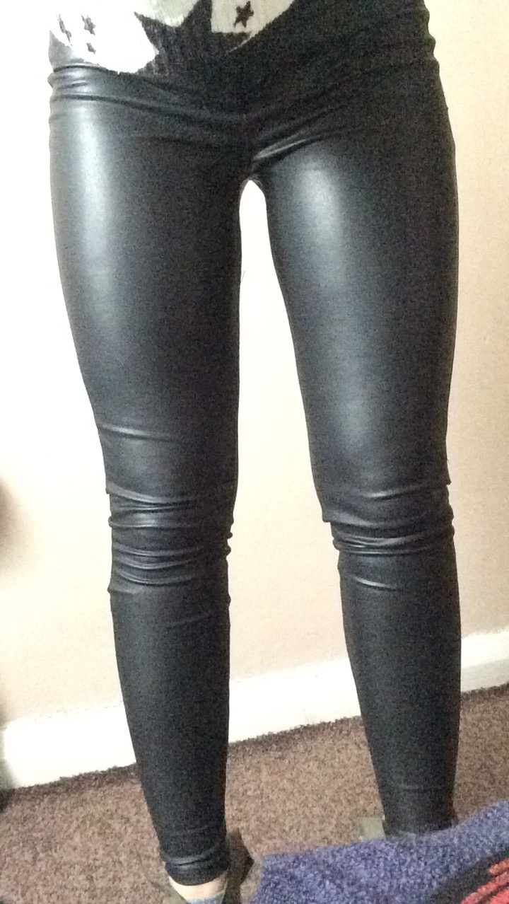 A pair of black leather trousers.