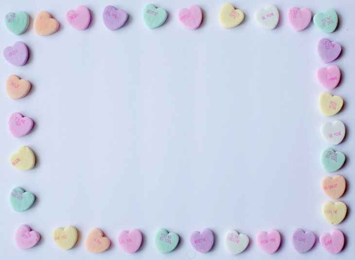 A border on a piece of paper of love hearts the sweets.