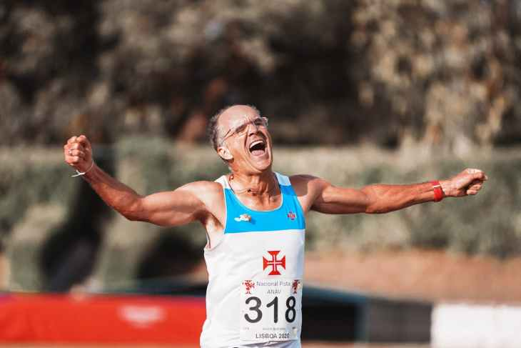 excited happy old man finishing sprint