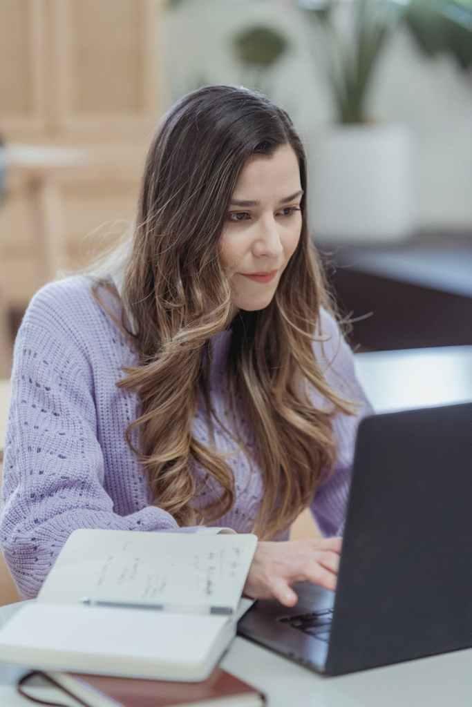 focused woman working on laptop