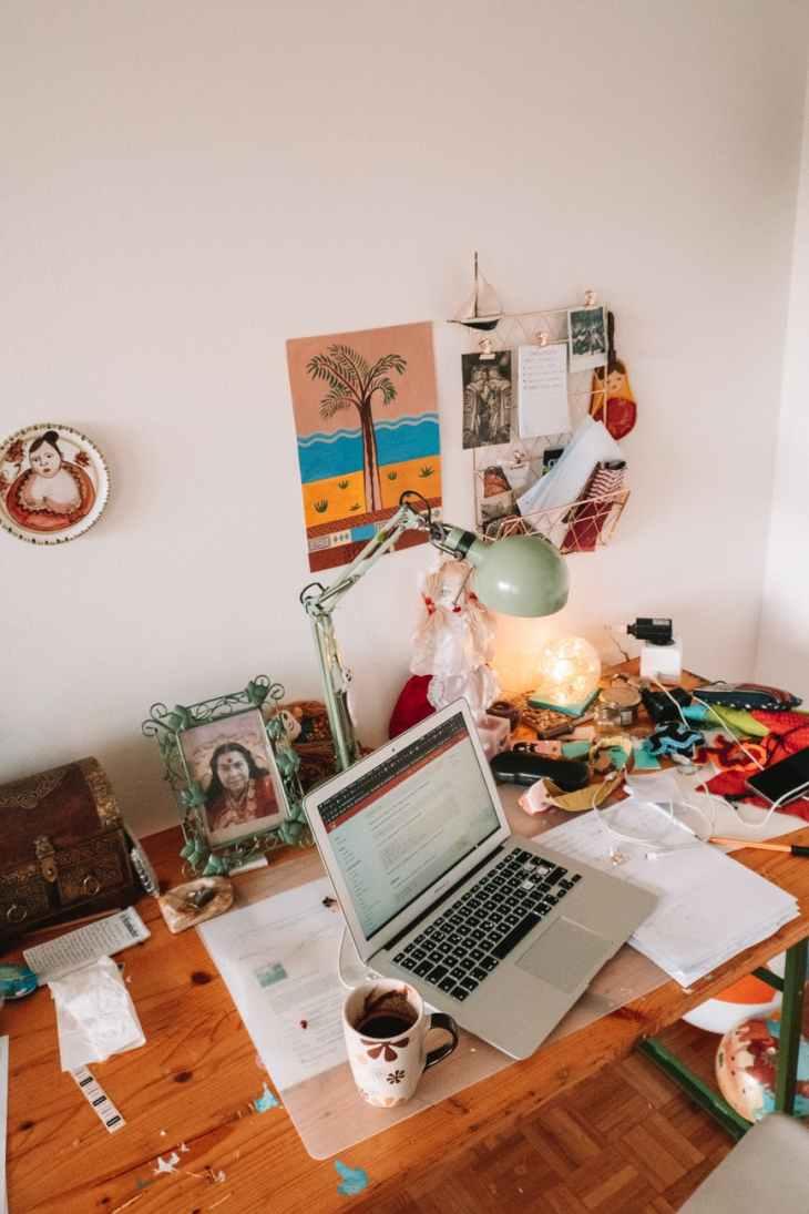 laptop on table beside mug
