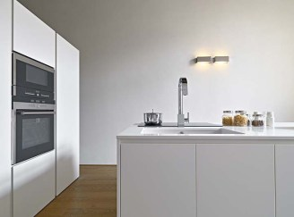 PROGETTO ANTONIO PERRONE interior view of a modern kitchen with litchen isalnd, sink and oven the floor is made of wood
