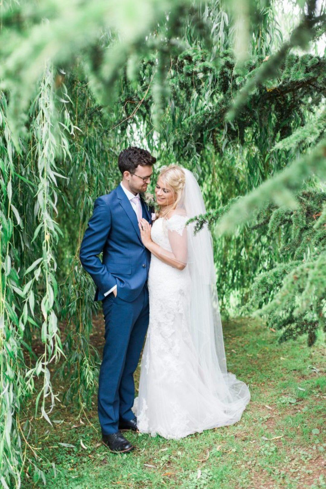 Wedding photos under a tree away from the rain