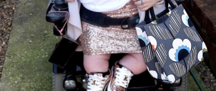Image of Gem holding bag