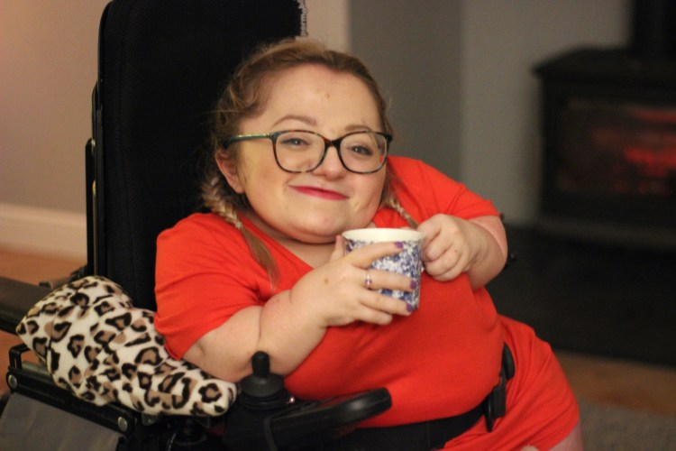 Gem Smiling holding a cup of tea