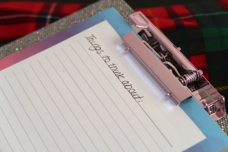 "Sparkly silver clipboard saying ""things to think about"""