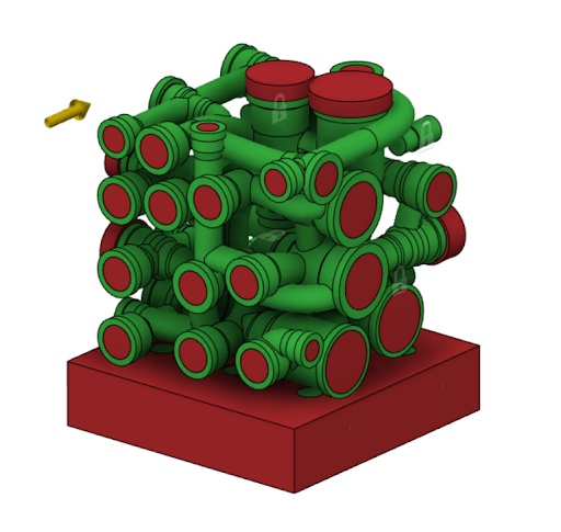 Generative design setup, the green section show the keep spaces that must remain in the design and the red sections show the areas that material cannot be placed. This may be for functional purposes such as fluid flow regions or for assembly considerations