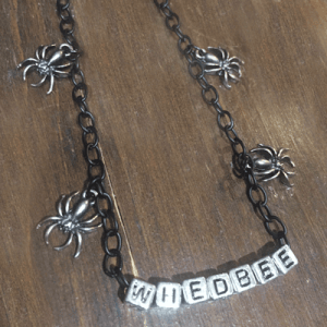 Name chain with 4 spider embellishment.