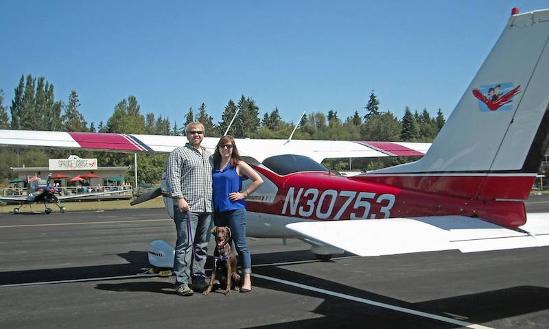 Tucker and Heidi Axum with their dog, XXX, a frequent passenger in the Cardinal.