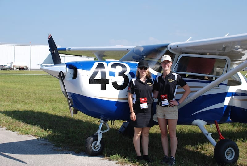 First place winners, Emmy Dillon and Amy Pasmore from Embry-Riddle Aeronautical University cool off with race plane, a Cessna Skyhawk.