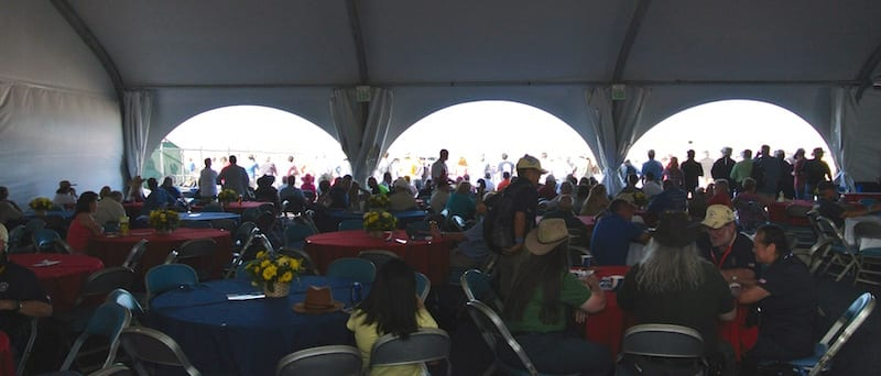 Shade is at a premium at Reno. Here members of the Chairman's Tent escape the sun. (Photo by William E. Dubois)