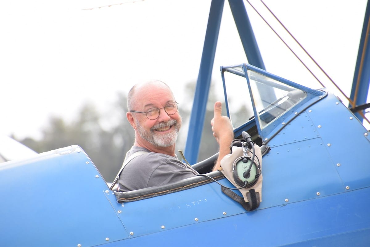 A happy Jamie Beckett after completing his Flight Review in a Boeing PT-17 Stearman.