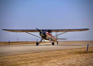 "The ""Green Acres"" Luscbome begins its takeoff roll."