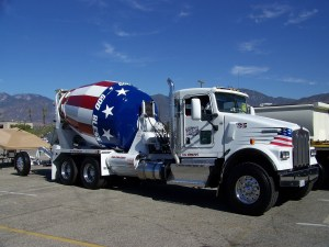 Why a cement truck's drum mixer rotates