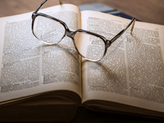 Glasses sitting on an open book