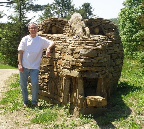 Raymond Hartman '69 stands beside his dry-laid stone dragon