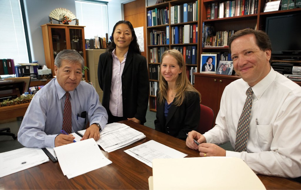 The Elder Abuse Justice Unit reviewing cases. (left to right) Keith Kaneshiro, Dawnie Ichimura, Kimberly Korte, and Lead Attorney Scott Spallina.