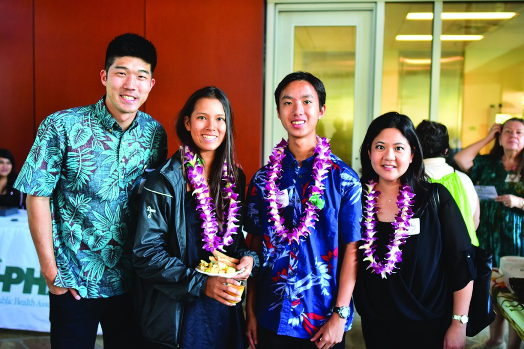 From Left: Colby Takeda; 'Iolani One Mile Project students Marley Dyer and Bryson Choy; and Christy Nishita, PhD.