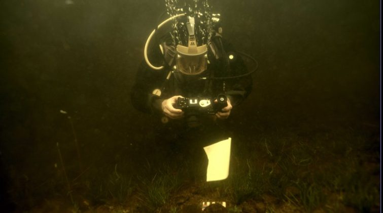 Jonathan Benjamin surveying underwater
