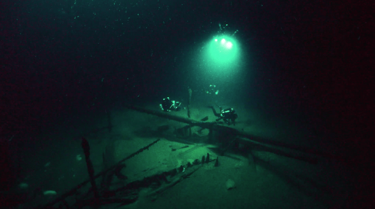 Professor Jon Adams inspects a 10th Century AD shipwreck, which lies 94m below the Black Sea surface. Photo Brian Gåre