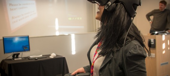 A woman wearing a VR headset.